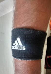Adidas reversible wristband in action